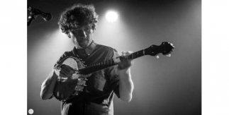 Sam Amidom. Photo by Dimly lit stages